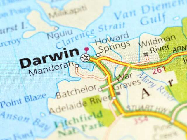 You must bring the kids to Crocosaurus Cove in Darwin, Australia