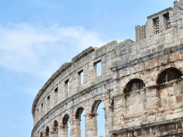 Visit one of the six largest surviving Roman arenas in the world in Pula, Croatia