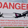 Warning Sign Maho Beach BestTripTV.png