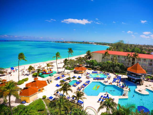 WestJet Vacations - Receive $100 in Breezes Bucks resort credit!