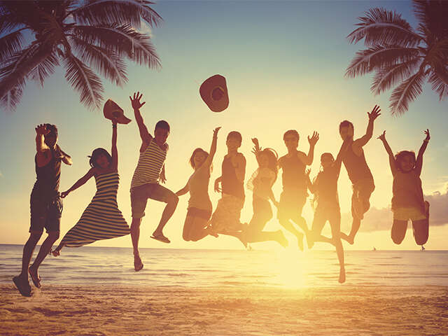ACV_Group Travel_Hero Image_people jumping at beach_Jun2019.jpg